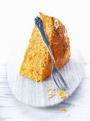 A slice of pumpkin cake with a fork
