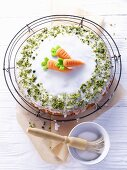 Carrot cake with sugar icing and pistachios