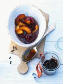 Plums in vinegar with cinnamon and cloves