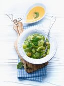 Green fruit compote with grapes and kiwis