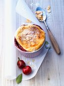 Quark soufflé with cherries and sliced almonds