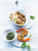 Vegetable risotto and shrimp kebabs with pesto