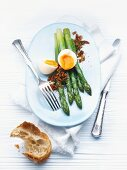 Green asparagus with soft-boiled egg and crispy bacon