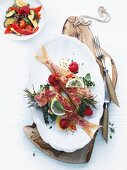 Red mullet with fresh raspberries, herbs and chilies