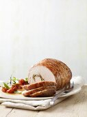 Veal roulade with tomatoes, sliced