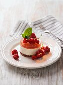 Quark cake with berry jelly, raspberries and red currants