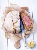 Roast, rolled wild boar in a bread crust