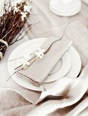 Easter place setting with cloth serviette and twigs