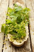 Maple leaves and flowers on a wooden serving platter