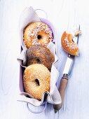 Three bagels in a bread basket