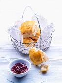 Scones in a bread basket with jam