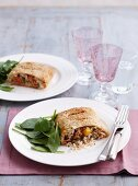 Salmon strudel with rice and spinach leaves