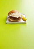 Reuben Burger on a Bun with a Pickle