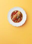 Chicken Cacciatore on a White Plate