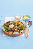 Warm vegetable salad with sausage