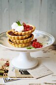 Mini pie with red currants jelly and goat cheese mousse