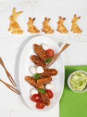 Vegetable croquettes, mozzarella, tomatoes, avocado dip and rabbit-shaped biscuits