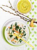 Exotic chicken soup with coconut milk and spinach, rabbit-shaped biscuits and baby food