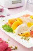 Fruit salad with strawberry foam and strawberry sauce