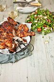 Grilled chicken with a bean and chorizo salad