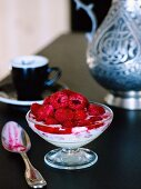 Ice cream with raspberries, rose water and grappa consomme