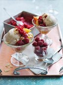 Nellie Melba – an ice cream sundae made with almond ice cream, fresh raspberries and peaches – with a tub of raspberry granita in the background