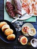 Tigelle (Italian bread rolls) with salami and Parma ham
