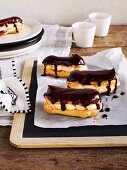 Vanilla-caramel éclairs with chocolate glaze