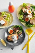 Salmon cakes with a colourful salad