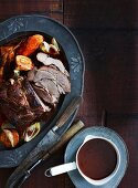 Roast beef with root vegetables and a dark gravy