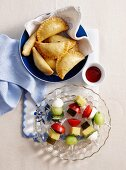 Stuffed pasties and melon skewers