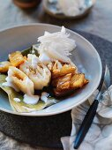 Stick rice pockets with caramelised pineapple and coconut cream