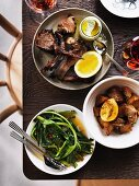 Slow roasted spiced lamb with tzatziki, lemon potatoes and wild vegetables