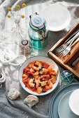 Saganaki-style prawns with halloumi on a table laid with maritime decorations