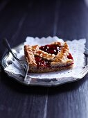 A Linzer Schnitte (nutty shortcrust biscuit topped with jam)