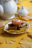 Assorted cakes and pastries on a gingko leaf