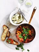 Piperade with curd cheese and slices of baguette