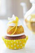 A lemon cupcake with meringue