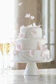 Three-tier wedding cake with paper butterflies