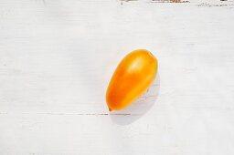 A tomato of the variety 'Orange Liane'