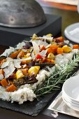 Corn pudding with sage and onion served with oven-roasted vegetables