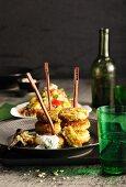 Falafel skewers with sesame seeds, dip and tabbouleh