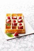 Waffle with lemon cream and fresh raspberries