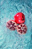 Pomegranates in water