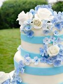 Pretty Blue and White Wedding Cake on an Outdoor Table