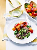 Peppercorn lamb fillets in herb vinaigrette with tomato medley