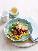 Chinese noodle omelette with pork
