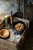 Chicken kali masala with cashew nuts in an old wooden crate