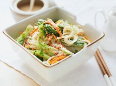 Rice noodles with carrots, pak choi and peanut sauce (Asia)