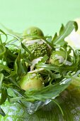 Rocket salad with avocado balls and wasabi sesame seeds